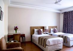알피나 호텔 & 스위트 - 뉴델리 - 침실
