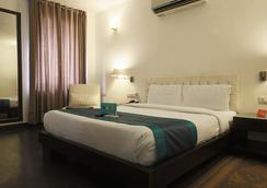 패브호텔 트리니티 아트 사켓 - 뉴델리 - 침실