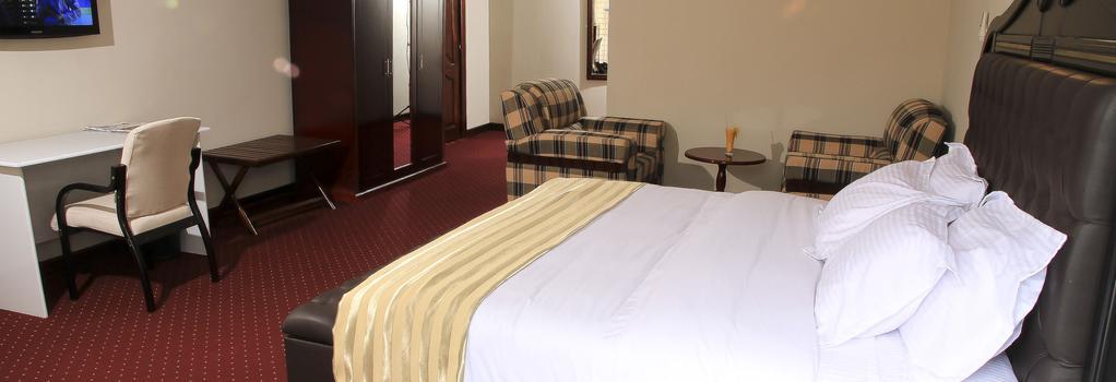 New Agena Hotel - Bujumbura - 침실