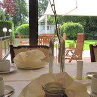 호텔 하우스 암 주 Covered table