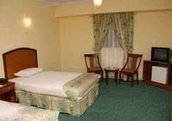 호텔 크라운 인 - 카라치 - 침실