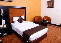 로얄 그랜드 스위트 호텔 - 샤르자 - 침실