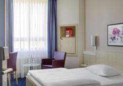 Intercityhotel Augsburg - 아우크스부르크 - 침실