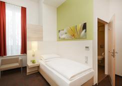 H+ 호텔 뮌헨 시티 센터 B&B - 뮌헨 - 침실