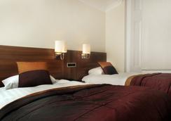 런던 하우스 호텔 - 런던 - 침실
