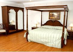 하리 니와스 팰리스 - Jammu - 침실