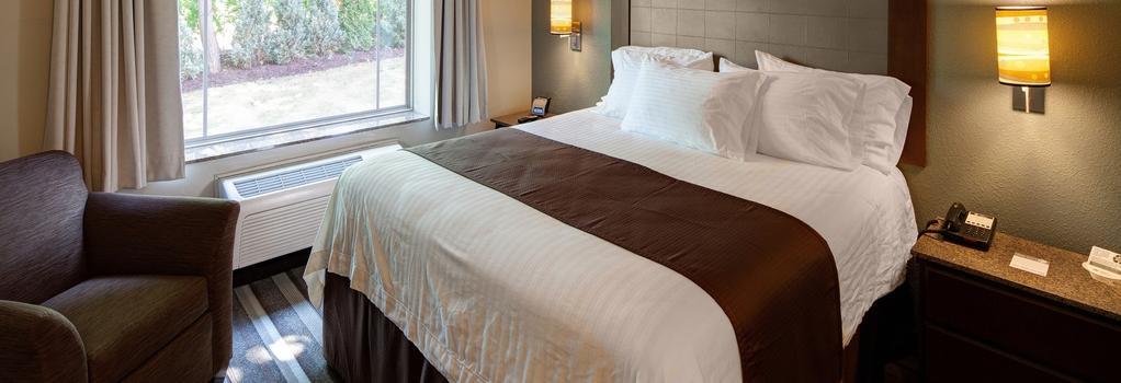 The East Avenue Inn & Suites - 로체스터 - 침실