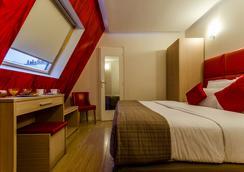 리비에라 호텔 - 파리 - 침실