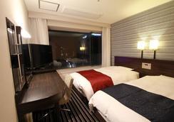 APA 호텔 후쿠오카 와타나베도리 에키마에 엑셀런트 - 후쿠오카 - 침실