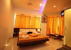 La Hotel Metro - 뭄바이 - 침실