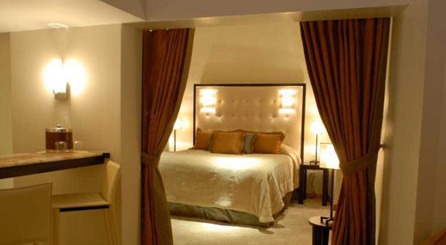 El Cervantes Hotel - 산후안 - 침실