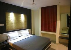 호텔 돌핀 인터내셔널 - 바라나시 - 침실
