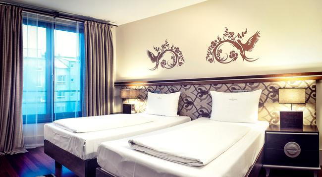 호텔 앰비앙쓰 리볼리 - 뮌헨 - 침실
