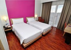 퀘스트 호텔 세마랑 - Semarang - 침실