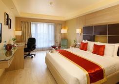라 클래식 호텔 - 벵갈루루 - 침실