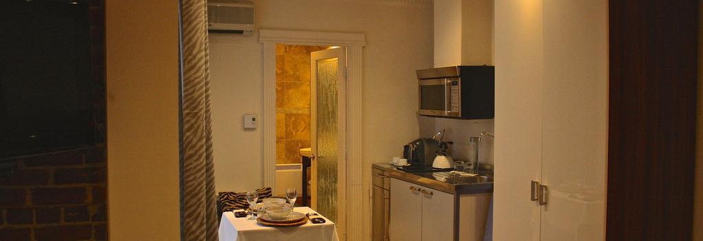 Kutuma Hotel & Suites - 몬트리올 - 침실