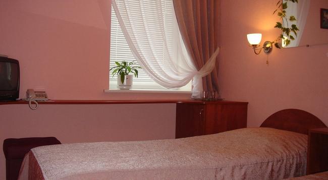 Business Hotel na Bumazhnoy - 상트페테르부르크 - 침실