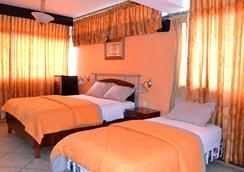 Hotel Malecon Inn - 과야킬 - 침실