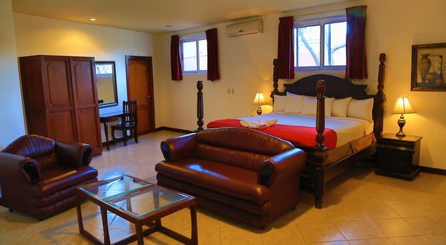 Hotel Le Chateau - 마나과 - 침실
