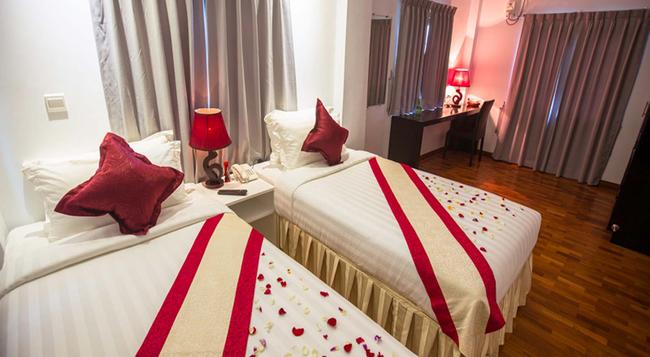 WH 호텔 앤 서비스 아파트먼트 - 양곤 - 침실