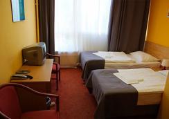 악투어 시티 호텔 - 베를린 - 침실