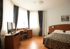 Hospitality Hotel - 페트로자봇스크 - 침실