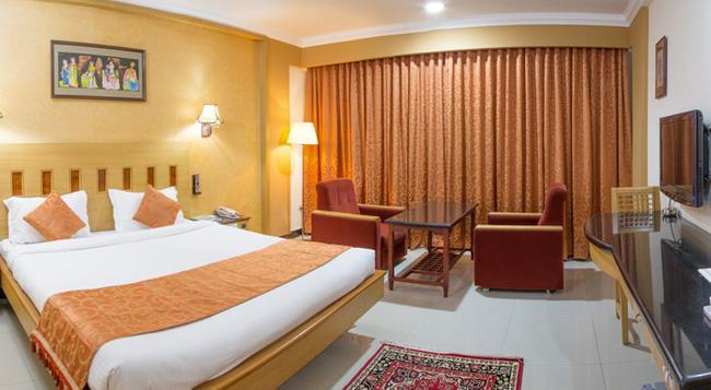 람야스 호텔스 - Tiruchirappalli - 침실