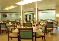 람야스 호텔스 - Tiruchirappalli - 레스토랑