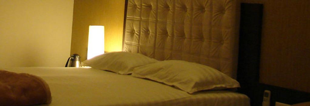 호텔 바세라 - 푸네 - 침실
