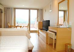 수안보 파크 호텔 - 충주 - 침실