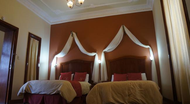 Hotel Boutique La Circasiana - 키토 - 침실