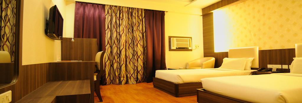 Hotel The Sojourn - 콜카타 - 침실