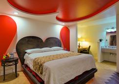 Romantic Inn & Suites - 댈러스 - 침실