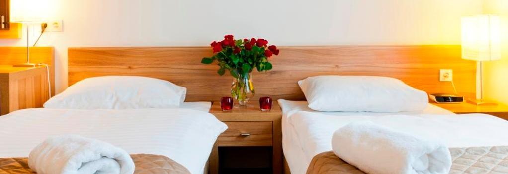 아파트호텔 페르가민 - 크라쿠프 - 침실
