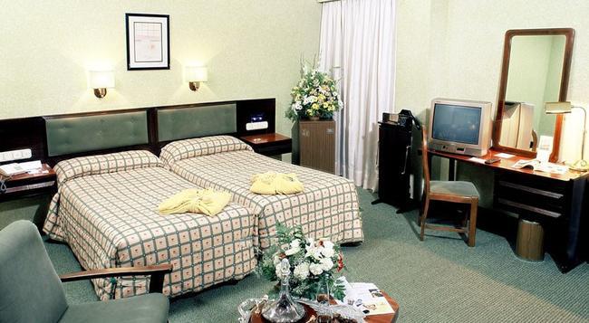마시아 그란 라르 - 세비야 - 침실