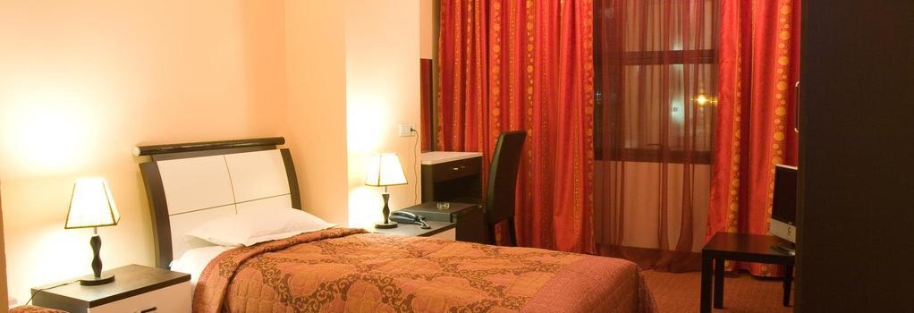 Lina Hotel - 부쿠레슈티 - 침실
