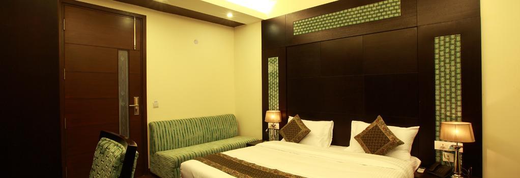 Hotel Zara Grand - 뉴델리 - 침실