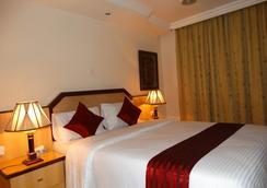 메이페어 호텔 - Dar Es Salaam - 침실