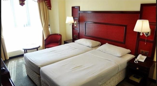 뉴 페닌슐라 호텔 - 두바이 - 침실