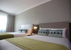 Aranjuez Hotel & Suites - 다비드 - 침실