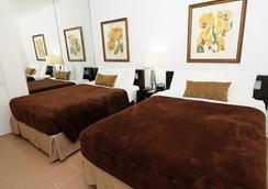 Tres Palmas Inn - 산후안 - 침실