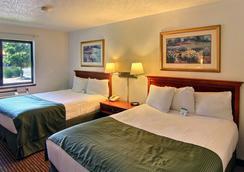 Days Inn & Suites Traverse City - 트래버스시티 - 침실