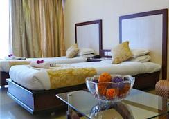 더 한스 호텔 - Hubli - 침실