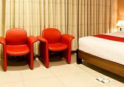 스위트 카리나 호텔 - 반둥 - 침실