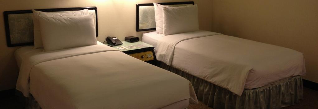 프리미어 호텔 - Tainan - 침실