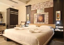 호텔 MMR 가든스 - Madurai - 침실