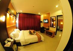 Hotel Swarna Dwipa - 팔렘방 - 침실