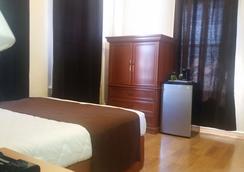 이스트 웨스트 호텔 - 로스앤젤레스 - 침실