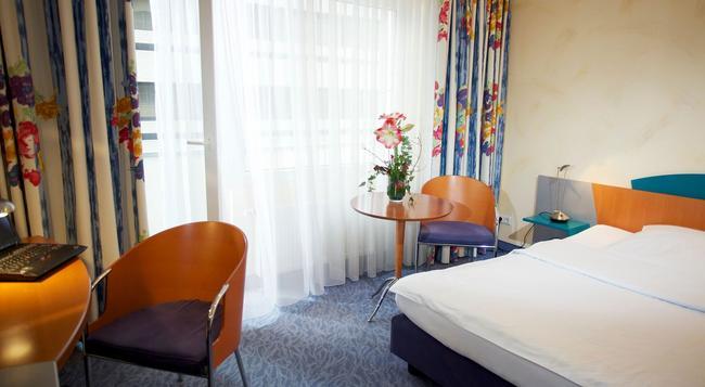 호텔 코에니그쇼프 암 펀크텀 - 하노버 - 침실