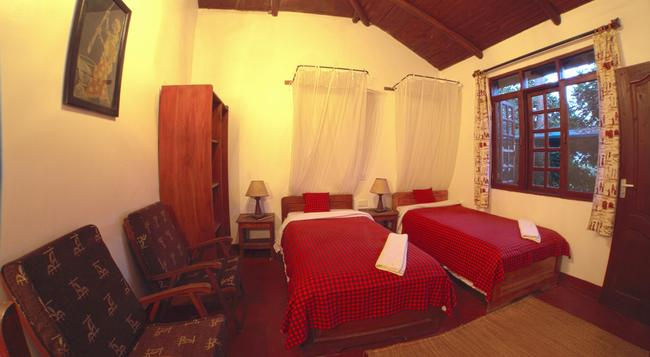 Safariland Cottages - Arusha - 침실